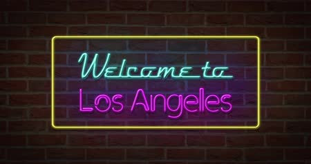 Neon text sign of Welcome to Los Angeles in brick background