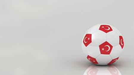 sobre o branco : Very highly detailed Turkish soccer ball rotating over bright glossy surface - seamless