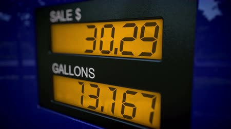 custo : 4K real time with slow zoom in on gas pump display showing rising numbers starting at 28 Dollars.