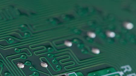 основной : Rack focus macro shot of traces and soldering points on a circuit board