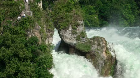 švýcarský : Closeup view of the Rhine Falls being 450 ft wide and 75 ft high with a water flow of 700qm per second.