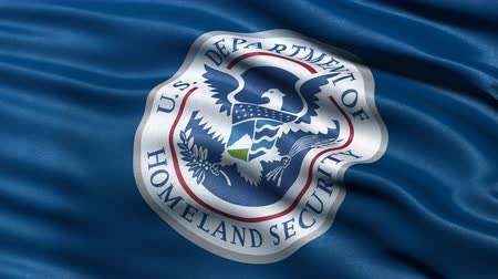 безопасность : 4K USA Homeland Security flag waving in the wind. Seamless loop with highly detailed fabric texture.