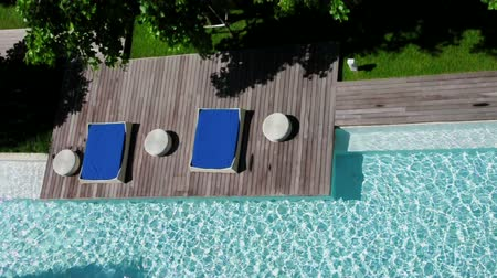 Relaxation area for sunbathing bybeside the pool. (HD footage with sound) Stock Footage