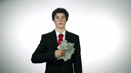 finanças : Young business man throwing money towards camera