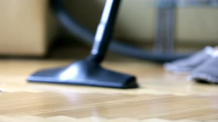 szőnyeg : Vacuuming debris on floor parquet Stock mozgókép