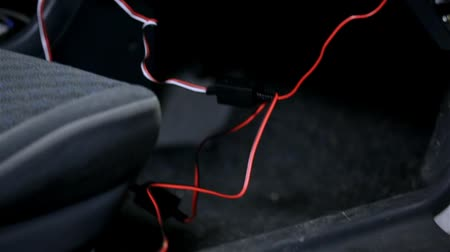 кража : Close up tracking of car radio wires for new audio acoustic
