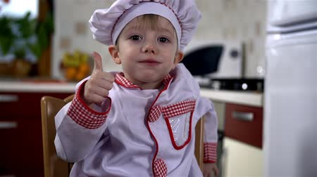 keksz : Little cook eating cookie and showing thumbs up