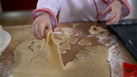 cooks : Little cook removing dough around hearts