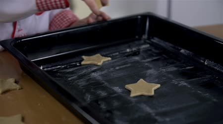 bolachas : Laying star cookies on tray for baking Stock Footage