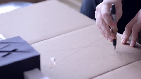 planos : Drawing Circle on Paperboard Stock Footage