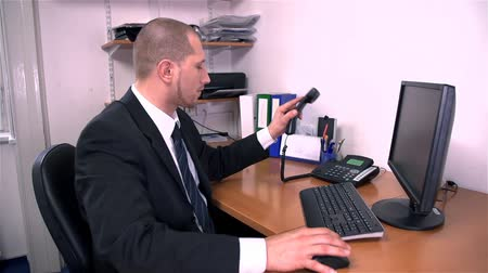 mobbing : Business Man In Office Picking Up Telephone Wideo