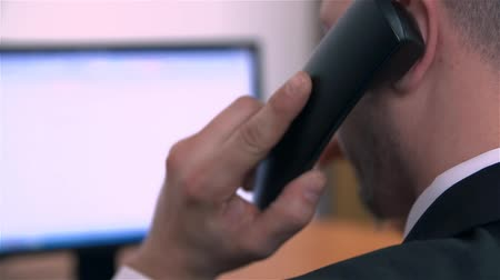 mobbing : Telephone Call At Work in Office Wideo