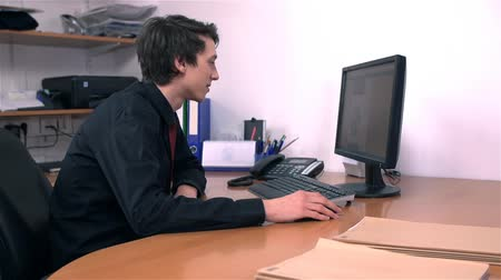 mobbing : Young Business Man In Office Working on PC