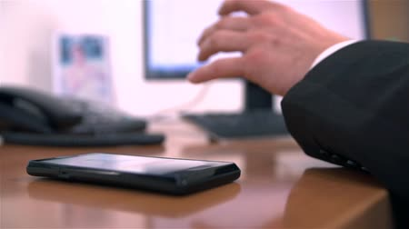mobbing : Office Worker Picking Up Mobile Phone in Slow Motion Wideo