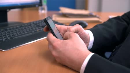 mobbing : Office Worker Writing Text Message On Mobile Phone