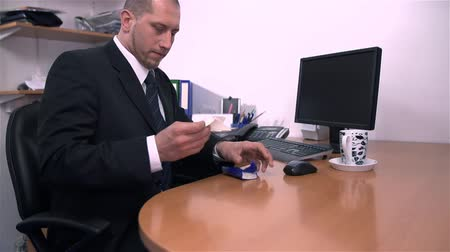 mobbing : Businessman in Office Taking Tissue And Cleaning Suit