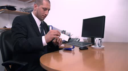 boss : Cleaning Business Suit With Tissue in Office