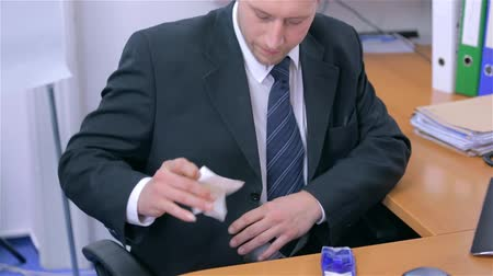 small businessman : Businessman Cleaning Suit With Tissue