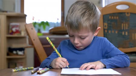 preschool : Creative Kid Drawing With Unique Pencil On Paper Stock Footage