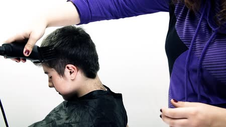 keser : Young Man At Hairdresser Getting New Hair Cut