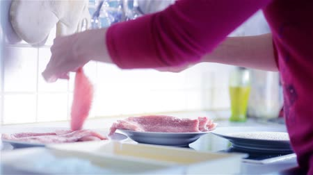 schabowy : Wide Shot Salting Wiener Schnitzel Raw Meat