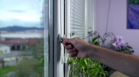 persiana : Closing Iron Blinds on Windows Slow Motion Stock Footage