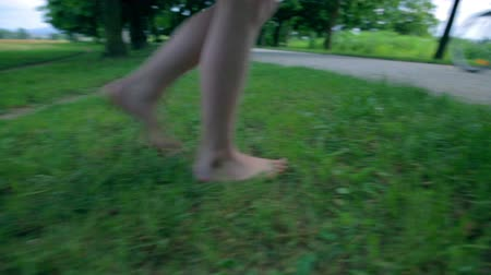 boso : Girl Barefoot Walking on Grass and Footpath