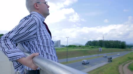 bridges : Businessman On The Edge of Bridge Doing Suicide Stock Footage