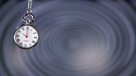 hipnoza : Swinging Small Pocket Watch Slow Motion. Classic pocket clock swinging in front of hypnosis spiral.