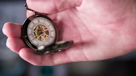 bolso : Setting Pocket Watch Ticking in Slow Motion. Small pocket clock in man hands close up. Stock Footage