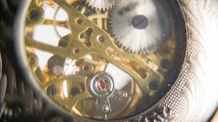 eski moda : Moving Mechanism of Clock in Slow motion. Analogue pocket watch slow motion ticking mechanism on white background macro. Stok Video