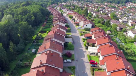 arrabaldes : Aerial Flight Over Houses in Rows. Flying over suburban houses neighborhood at sunset.