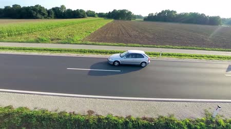 straight road : Side aerial flying with car vehicle on road