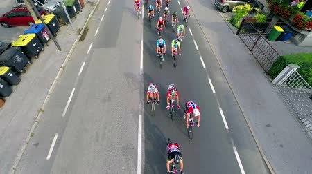 cycle : LJUBLJANA, SLOVENIA - AUGUST 2014: UCI World Cycling Tour competition with start in shopping center BTC in Ljubljana. Top view of cyclist driving bellow in slow motion Stock Footage