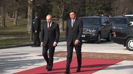 kgb : LJUBLJANA, SLOVENIA - NOVEMBER 27 - Russian Prime minister Vladimir Putin visits Slovenian Prime minister Borut Pahor in 2011. Vladimir Putin and Borut Pahor walking on red carpet