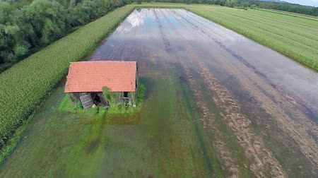floods : Flying over barn house uncovering flooded field with clouds reflection