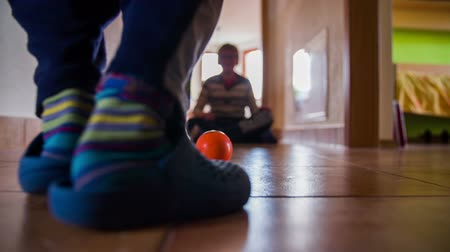 прихожая : Setting and kicking ball in door goal at home. Kids playing soccer at home with doors being as goal and small soft ball with smile. Shot at low angle slow motion.