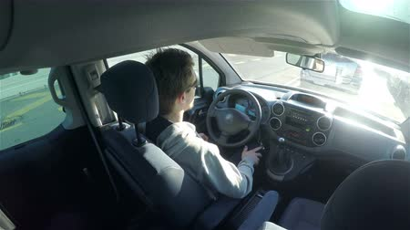přístrojová deska : Driving car inside view timelapse 4K. Driving car vehicle view from inside car bellow roof in the back, young attractive man steering wheel. Ultra-High definition video.
