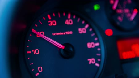 counter : Analogue rev up counter in car. Pushing throttle in car, rev counter showing speed of motor. Stock Footage