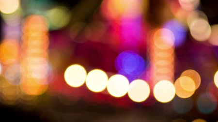 ярмарка : Blurred bokeh shiny lights adventureland. Night bokeh with out of focus camera of light sign shining.