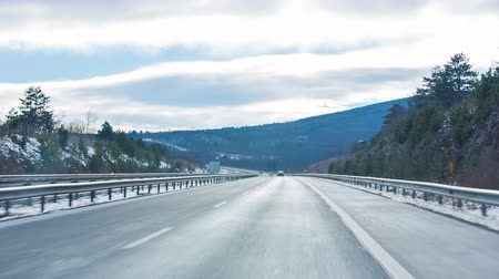 straight road : Driving on highway. Personal view from car while driving on highway through countryside in winter with bright clouds. Stock Footage