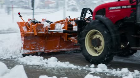 deep snow : Removing snow with plow. Close up of iron snowplow pushing a lot of snow away.