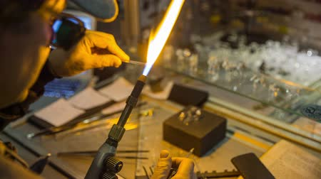 zanaat : Person working with glassblower. Person with flames designing decorative from glass material.