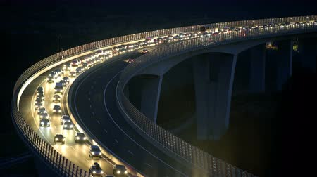 řídit : Slow drive on highway at night on viaduct 4K. Tourists returning from vacation, hitting traffic jam at night on highway. Above viaduct view.