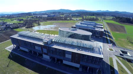 složitý : Aerial view of low profile business buildings with strong back light..Flying over new business bulldings complext 4K