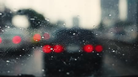 jam : View of a car windshield with wipers, stuck in traffic during a rain storm Stock Footage