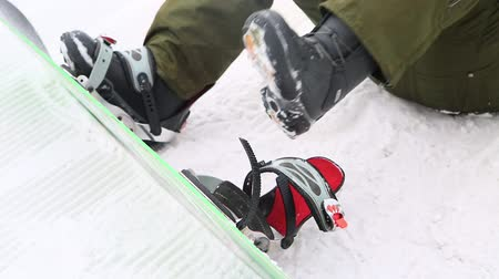 fasteners : close up to put a snowboard in the winter Stock Footage