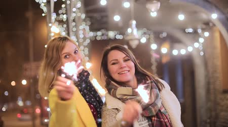 otwarcie : young women with sparklers on the background of night city