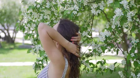 smell : young woman enjoying in the background of the tree Stock Footage