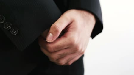 apprehensive : Hands of formally dressed man patiently waiting Stock Footage